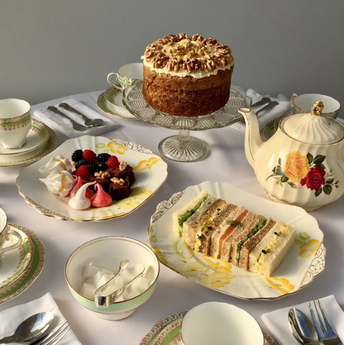 Delicious afternoon tea, finger sandwiches, cream scones, macaroons and homemade cakes.